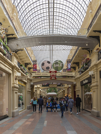 Moscow - June 14, 2018: Tourists on shopping in the central Moscow historical arcade - GUM and a beautiful glass ceiling in the store June 14, 2018, Moscow, Russia