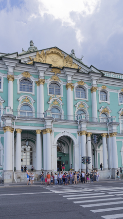 St. Petersburg - August 12, 2018: Beautiful museum building with columns - entrance to the State Hermitage and many people want to cross the road August 12, 2018, St. Petersburg, Russia Editöryel