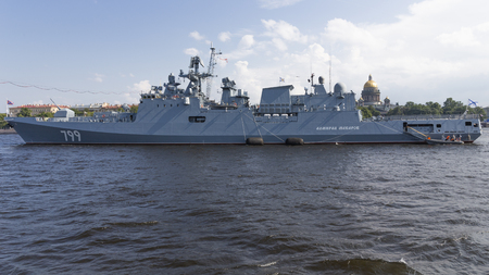 St. Petersburg - August 12, 2018: Frigate Admiral Makarov at a parade in honor of the Navy against the backdrop of St. Isaacs Cathedral August 12, 2018, St. Petersburg, Russia