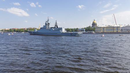 St. Petersburg - August 12, 2018: a large anti-submarine ship Soprovidelny on the parade in honor of the day of the Navy against the backdrop of the St. Isaacs Cathedral August 12, 2018, St. Petersburg, Russia Editorial