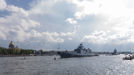 St. Petersburg - August 12, 2018: Ships and Frigate Admiral Makarov at a parade in honor of the Navy Day against the backdrop of St. Isaacs Cathedral August 12, 2018, St. Petersburg, Russia