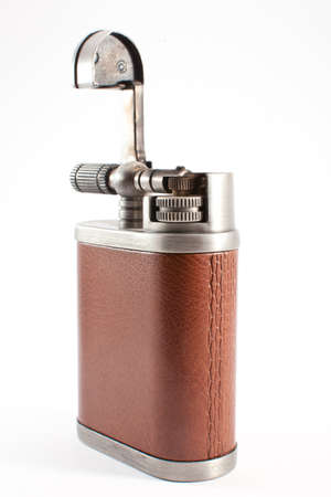 gas lighter with a leather covering on a white background Stock Photo - 13148561