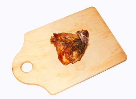 fried piece of chicken on a chopping board on a white background photo