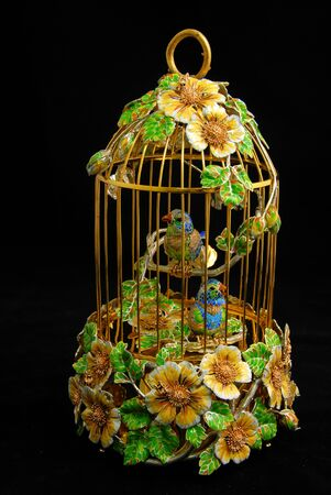 canaries: Exclusive cage with canaries of gold, silver and precious stones Stock Photo