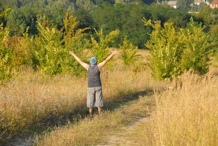 rejoicing: Rejoicing man on the field in Ukraine