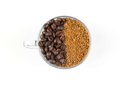 bisected: Coffee beans and ground in a glass cup bisected