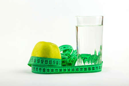 Green apple and glass of water wrapped meter photo
