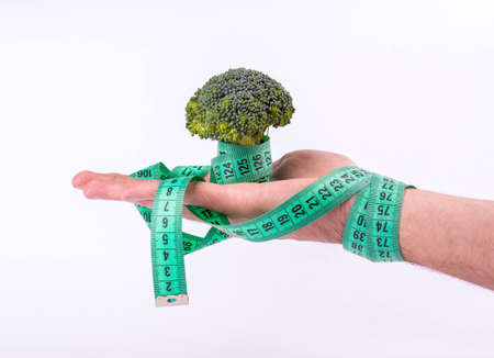 Broccoli wrapped in a hand meter photo