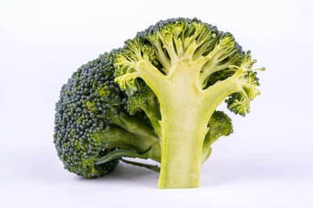 two and a half: Two branches of broccoli, one of which cut in half Stock Photo