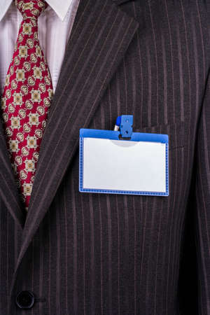 Blank badge blue plastic on a business suit manager photo