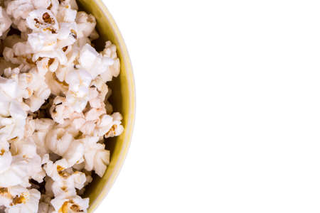 half full: Half full bowl of popcorn on a white background