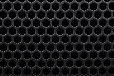 metal grate: Black background metal grate with holes Stock Photo