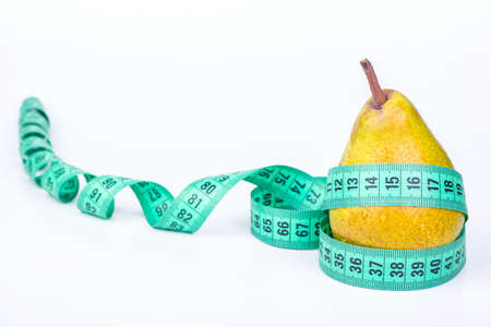 windings: Pear wrapped in a meter with a continuation of the windings of the tape Stock Photo