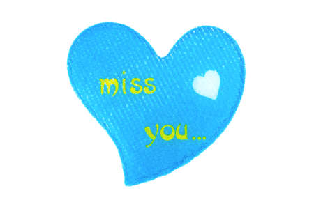 i miss you: Blue heart made of cloth with symbols I miss you Stock Photo