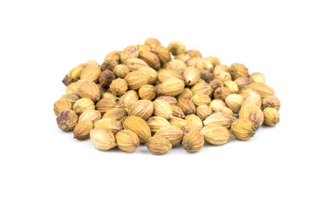 A bunch of coriander seeds on a white background photo