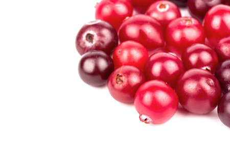 medium group of object: The scattered ripe red cranberries on white background