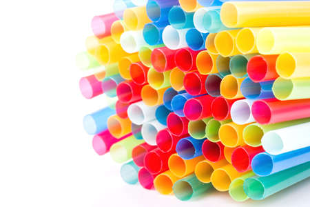 Multicoloured tubes for drinking on a white background photo