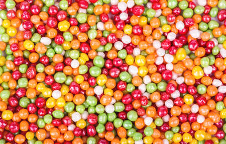plurality: Background of the plurality scattered multicolored round sweets