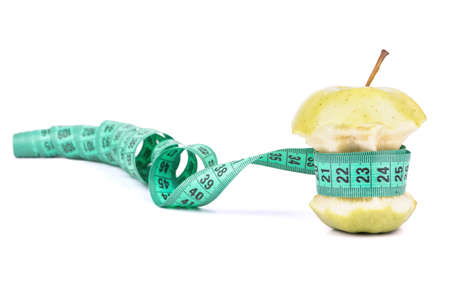Apple core wrapped in meter symbolizing Diet and Weight Loss