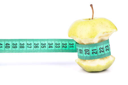 apple core: Apple core wrapped in meter symbolizing Diet and Weight Loss