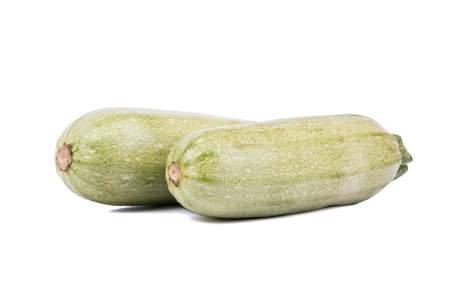 vegetable marrow: Two green vegetable marrow on a white background Stock Photo