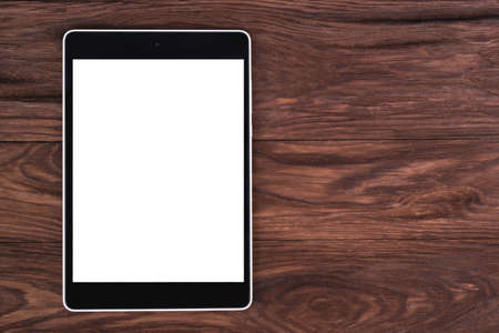 blank tablet: Tablet PC with a blank screen is a brown wooden background Stock Photo