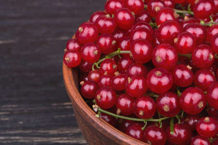 not full: Full bowl of fresh redcurrant not dark wooden background close-up Stock Photo