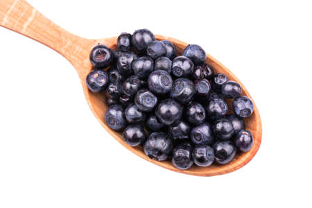 wooden spoon: Wooden spoon full of fresh blueberries close up on a white background