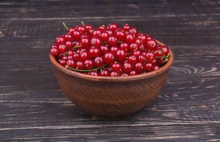not full: Full bowl of fresh redcurrant not dark wooden background
