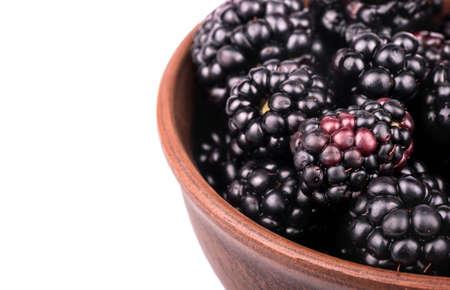 brambleberry: Full bowl of fresh blackberries close-up on a white background