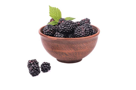 brambleberry: Full bowl of fresh blackberries with leaves isolated on a white background Stock Photo