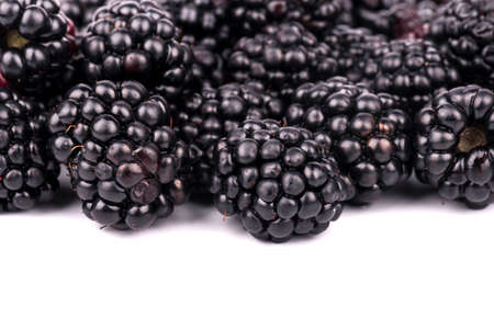 brambleberry: Are scattered fresh blackberries close-up on a white background Stock Photo