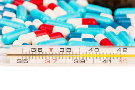 tempera: Tempera thermometer shows 39 degrees with scattered multicolored capsules
