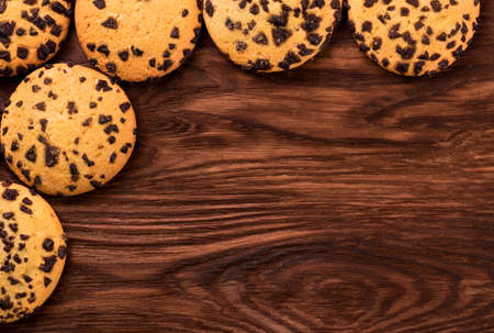 palatable: Homemade cookies with chocolate on an empty wooden background top view