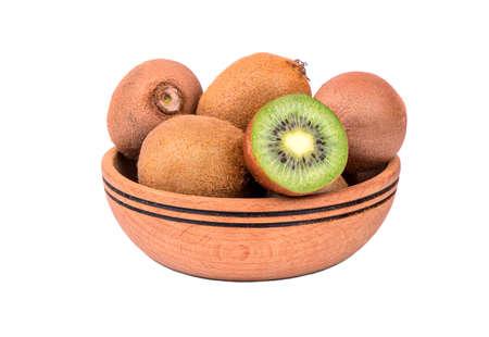 kiwi: Wooden bowl of fresh and juicy fruit kiwi on a white background