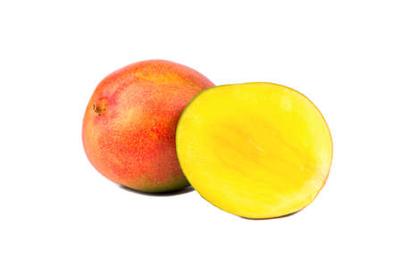 sweet pulp: Fresh mango fruit with cut juicy half on a white background