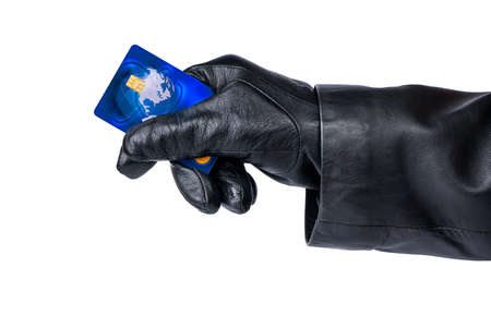 stolen: Thief in the hand holding the stolen credit card on a white background