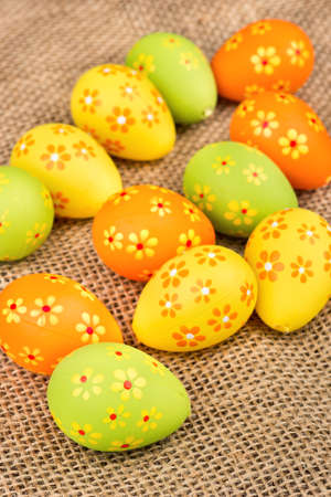 sackcloth: Scattered colorful decorative easter eggs on sackcloth Stock Photo