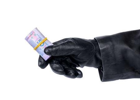 stolen: Thief in her hand holding a bunch of stolen Ukrainian money on a white background