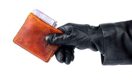 stolen: Thief holding in his hand stolen old purse with money on a white background