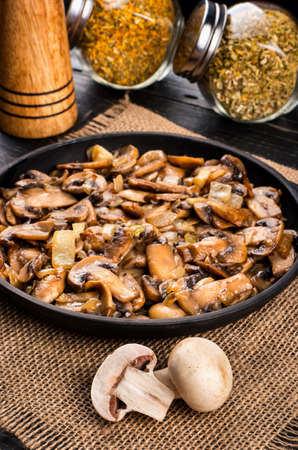sacking: Fried champignons with spices on sacking