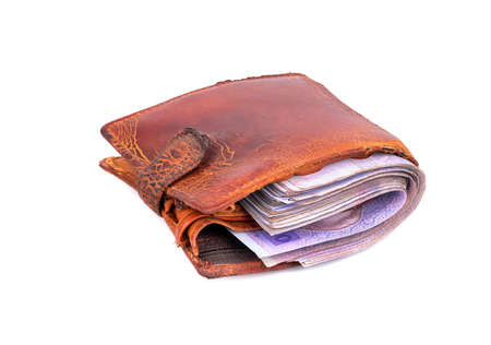 change purses: Old used wallet filled Ukrainian money on a white background Stock Photo