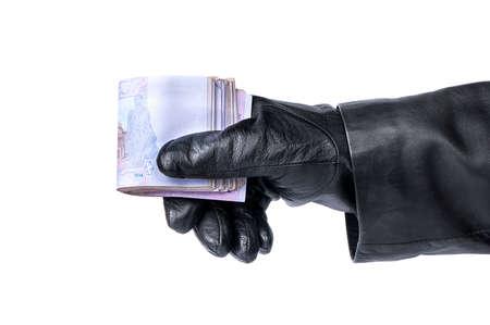 stolen: Thief holding in his hand stolen Ukrainian money on a white background Stock Photo