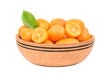 cumquat: Fresh fruit kumquat in a wooden bowl isolated on white background