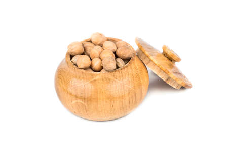 capacitance: Dry chickpeas in a wooden capacitance on a white background