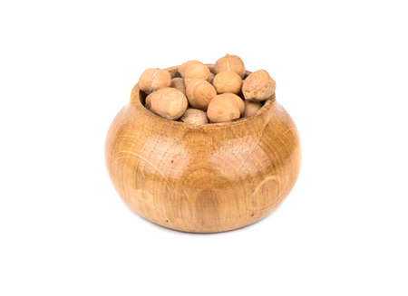 capacitance: Dry chickpeas in a wooden capacitance isolated on white background