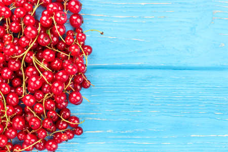 many branches: Many branches of fresh red currants on a blank wooden background Stock Photo