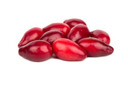Several ripe cornelian cherries on a white background Stock Photo