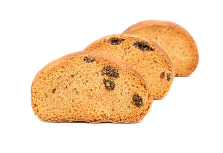 Three a rusks with raisins ranked on a white background