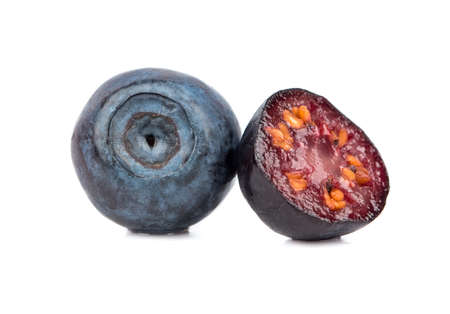 Fresh blueberries with a juicy half on a white background Banque d'images